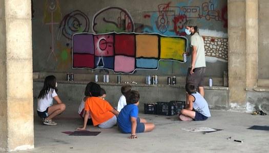 TALLER DE GRAFFITI al pati de l'escola d'Ivorra.